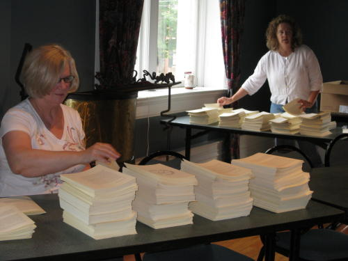 Mary and Lynn collating pages