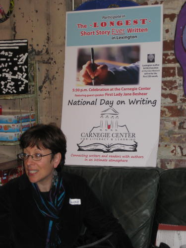 Gail with the poster advertising Lexington's writing event