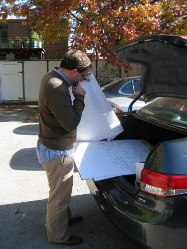 One more writer in the parking lot considers what to add before the writing pad moves on